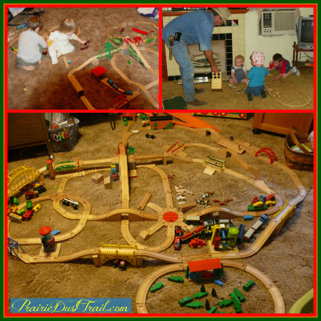 Playing trains with Grandpa. We love wooden train sets!